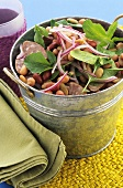 Bean and sausage salad in zinc bucket