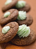 Chocolate macaroons with green cream