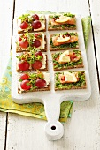 Canapes with salmon & chives and with feta & grapes