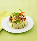 Asian chicken salad with papaya in cucumber ring