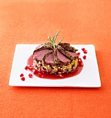 Coffee crusted loin of venison with bulgur and pomegranate seeds