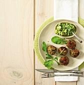 Lentil, spinach and feta balls served with avocado salsa