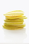 Apple slices, stacked to form an apple