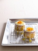 Small almond cakes with orange zest and coconut cream