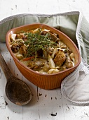 Braised chicken with parsnips and herbs