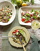 Grilled asparagus with aubergine salad and peppered beef fillet