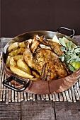 Roast chicken with lemon and Greek potatoes
