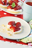 Strawberry shortcake with cream, partly eaten