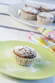Nut muffins sprinkled with icing sugar