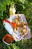 A platter of satay kebabs on the grass