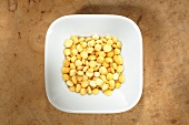 Yellow split-peas in dish from above