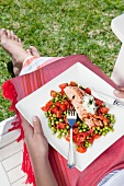 Poached salmon with peas and tomatoes