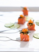 Salmon appetisers with wasabi mayo, keta caviar and fried seaweed