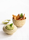 Potato wedges with avocado salsa