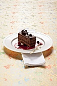 Chocolate mud cake with berry sauce