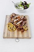 Crispy herb chicken with grilled lemon slices