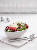 Tomato and pea salad with roasted chillies, Parmesan and pesto dressing