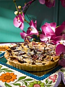 Fig tart with port wine sauce (Mexico)