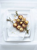 Ham-wrapped figs with ricotta and walnut stuffing on rosemary skewers