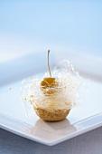Small apple cake with vanilla crème fraîche and spun sugar