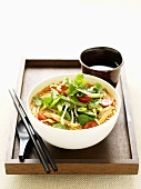 Chicken laksa with vegetables and mint (Asia)