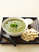 Curried spinach soup with naan bread