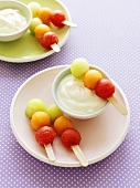 Melon balls on sticks with yoghurt dip