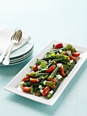 Vegetable salad with courgette flowers, tomatoes and goat's cheese