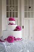 Three-tier wedding cake with decorated with flowers