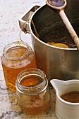 Orange marmalade in jars and pan