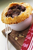Mushroom ragout in red wine sauce with puff pastry crust