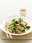 Asian noodle dish with chicken and broccoli