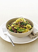 Asian beef with ginger, sprouts and noodles