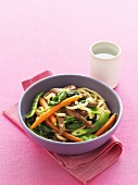 Udon noodles with beef and carrots in honey marinade