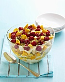 Trifle with cream, mango, passion fruit and raspberries