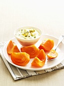 Pistachio yoghurt with passion fruit and persimmon