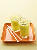 Two glasses of honeydew melon and pineapple juice
