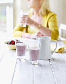 A woman with plum and berry smoothies