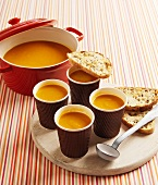 Pumpkin soup in pan and paper cups