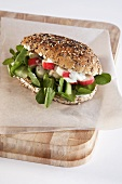Surimi and watercress in wholemeal roll