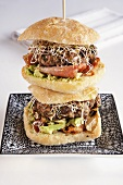 Burger with avocado, bacon and sprouts