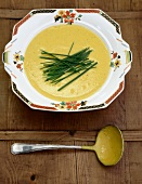 Cream of pumpkin soup garnished with chives