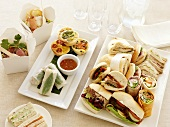 Assorted sandwiches, mini quiches and salads