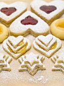 Assorted jam biscuits with icing sugar