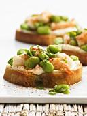 Bruschetta with prawn tartare and broad beans