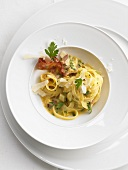 Tagliatelle alla carbonara (pasta with an egg and bacon sauce)