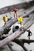 Toy football players on twigs