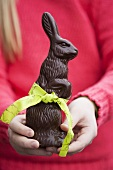 Girl holding chocolate Easter Bunny