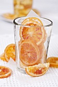 Candied orange slices in glass