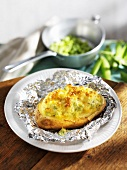 Baked potato with apple and peas